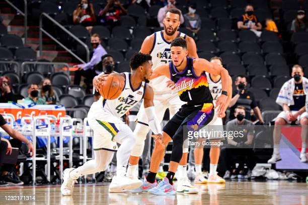 Donovan Mitchell of the Utah Jazz dribbles the ball during the game against the Phoenix Suns on April 7, 2021 at Phoenix Suns Arena in Phoenix,...
