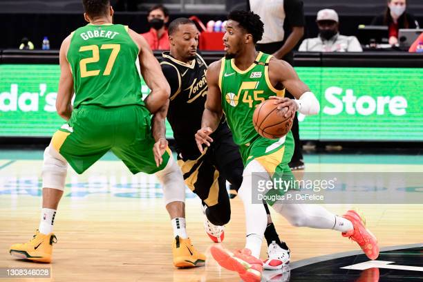 Donovan Mitchell of the Utah Jazz dribbles the ball during the second quarter against the Toronto Raptors at Amalie Arena on March 19, 2021 in Tampa,...