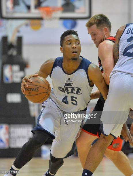 Donovan Mitchell of the Utah Jazz drives against Jake Layman of the Portland Trail Blazers during the 2017 Summer League at the Cox Pavilion on July...