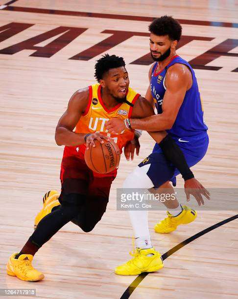 Donovan Mitchell of the Utah Jazz drives against Jamal Murray of the Denver Nuggets during the third quarter at The Arena at ESPN Wide World Of...