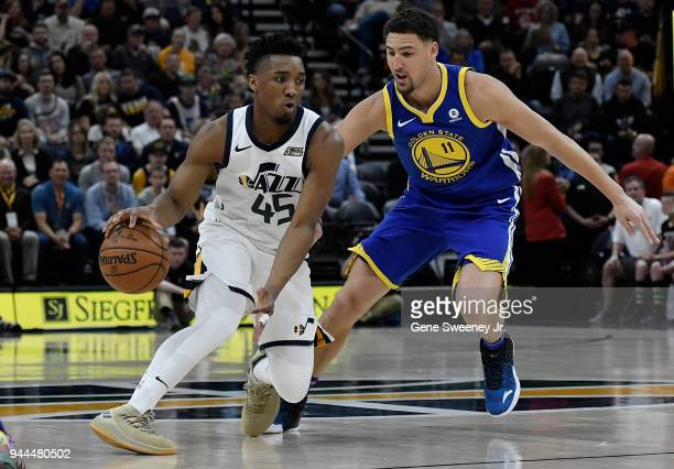 Donovan Mitchell of the Utah Jazz drives against Klay Thompson of the Golden State Warriors in the first half of a game at Vivint Smart Home Arena on...