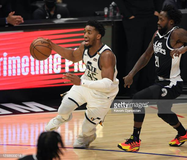 Donovan Mitchell of the Utah Jazz drives against Patrick Beverley of the Los Angeles Clippers during the first half in Game Six of the Western...