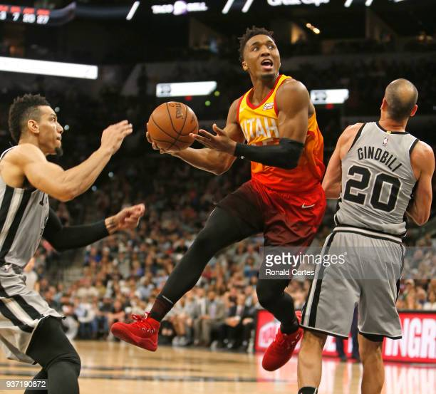 Donovan Mitchell of the Utah jazz drives by Manu Ginobili of the San Antonio Spurs at ATT Center on March 23 2018 in San Antonio Texas NOTE TO USER...