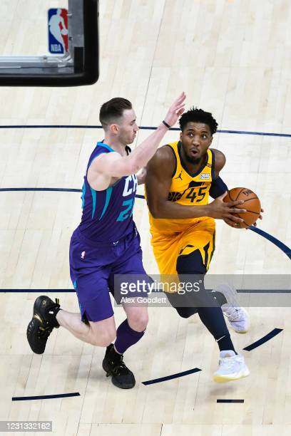 Donovan Mitchell of the Utah Jazz drives into Gordon Hayward of the Charlotte Hornets during a game at Vivint Smart Home Arena on February 22, 2021...