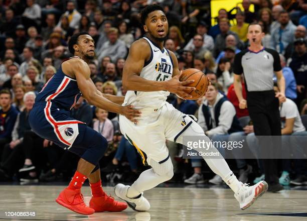 Donovan Mitchell of the Utah Jazz drives past Ish Smith of the Washington Wizards during a game at Vivint Smart Home Arena on February 28 2020 in...