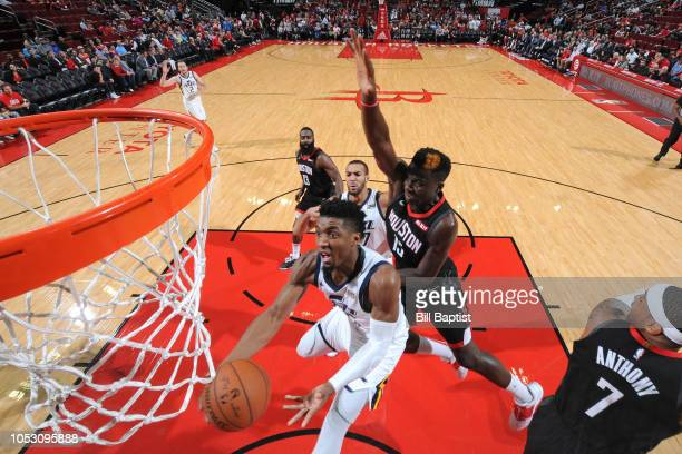 Donovan Mitchell of the Utah Jazz drives to the basket against Clint Capela of the Houston Rockets on October 24 2018 at Toyota Center in Houston...