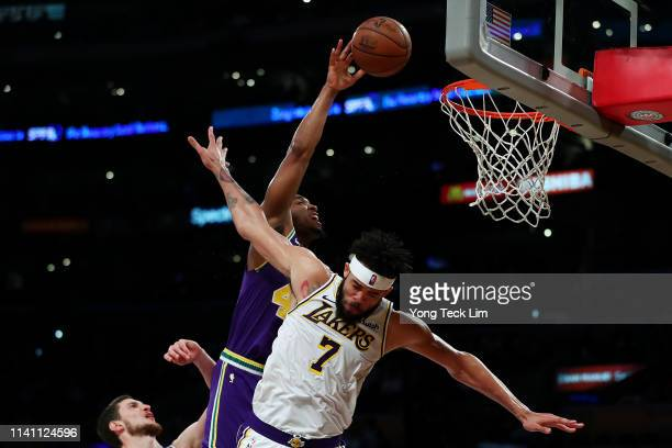 Donovan Mitchell of the Utah Jazz drives to the basket against JaVale McGee and Mike Muscala of the Los Angeles Lakers during the second half at...