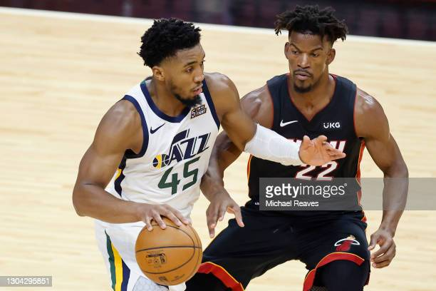 Donovan Mitchell of the Utah Jazz drives to the basket against Jimmy Butler of the Miami Heat during the third quarter at American Airlines Arena on...
