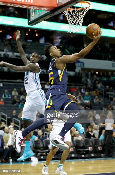 Donovan Mitchell of the Utah Jazz drives to the basket against Marvin Williams of the Charlotte Hornets during their game at Spectrum Center on...