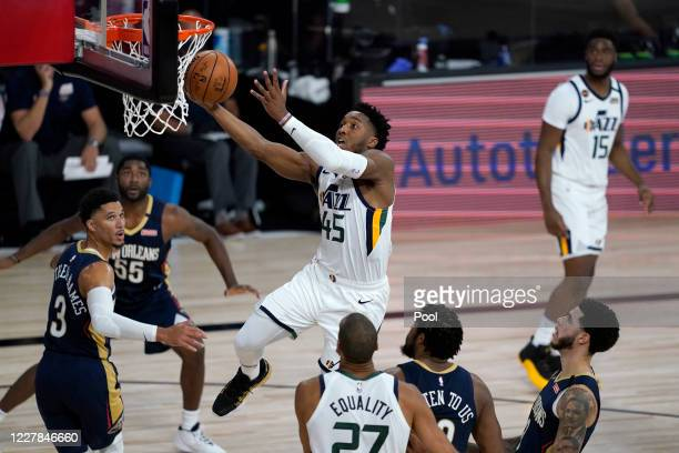 Donovan Mitchell of the Utah Jazz drives to the basket against the New Orleans Pelicans during the first half at HP Field House at ESPN Wide World Of...