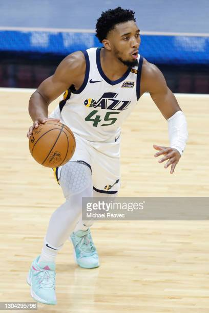 Donovan Mitchell of the Utah Jazz drives to the basket against the Miami Heat during the third quarter at American Airlines Arena on February 26,...