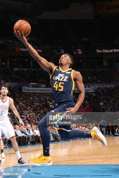 Donovan Mitchell of the Utah Jazz drives to the basket against the Oklahoma City Thunder on December 5 2017 at Chesapeake Energy Arena in Oklahoma...