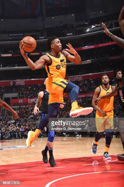 Donovan Mitchell of the Utah Jazz drives to the basket and passes the ball against the LA Clippers on November 30 2017 at STAPLES Center in Los...
