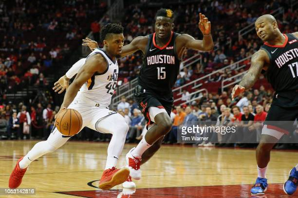 Donovan Mitchell of the Utah Jazz drives to the basket defended by Clint Capela of the Houston Rockets and PJ Tucker in the first half at Toyota...