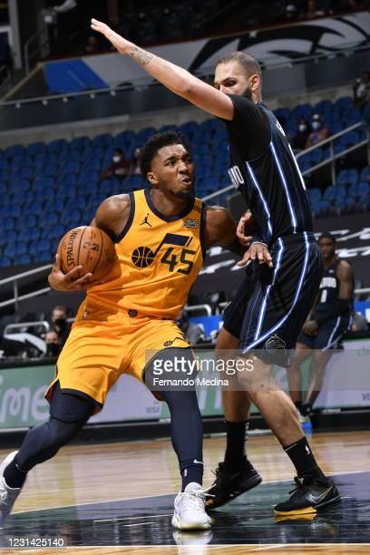 Donovan Mitchell of the Utah Jazz drives to the basket during the game against the Orlando Magic on February 27, 2021 at Amway Center in Orlando,...