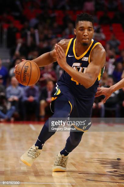 Donovan Mitchell of the Utah Jazz drives to the basket while playing the Detroit Pistons at Little Caesars Arena on January 24 2018 in Detroit...