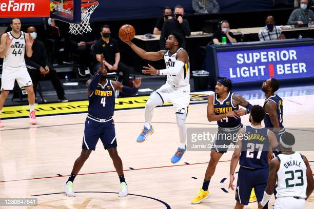 Donovan Mitchell of the Utah Jazz drives to the hoop in the second quarter against Paul Millsap of the Denver Nuggets at Ball Arena on January 17,...