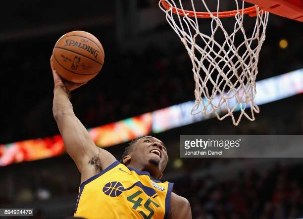 Donovan Mitchell of the Utah Jazz dunks against the Chicago Bulls at the United Center on December 13 2017 in Chicago Illinois The Bulls defeated the...