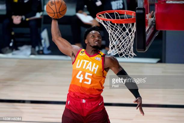 Donovan Mitchell of the Utah Jazz dunks against the Denver Nuggets during the second half of Game Three of first round playoffs at the AdventHealth...