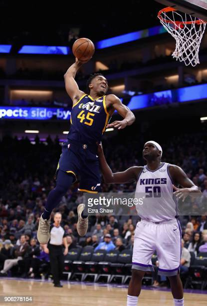 Donovan Mitchell of the Utah Jazz dunks on Zach Randolph of the Sacramento Kings at Golden 1 Center on January 17 2018 in Sacramento California NOTE...