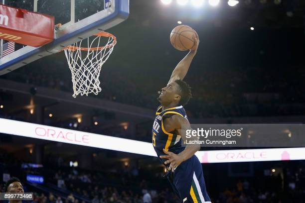 Donovan Mitchell of the Utah Jazz dunks the ball against the Golden State Warriors at ORACLE Arena on December 27 2017 in Oakland California NOTE TO...