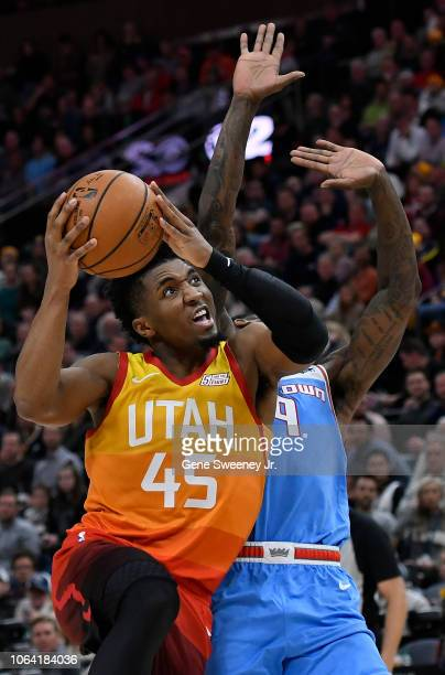 Donovan Mitchell of the Utah Jazz fouls Bogdan Bogdanovic of the Sacramento Kings on his way to the basket in the second half of a NBA game at Vivint...