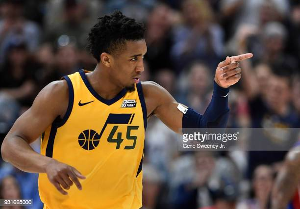 Donovan Mitchell of the Utah Jazz gestures after a basket against the Detroit Pistons in the second half of a game at Vivint Smart Home Arena on...
