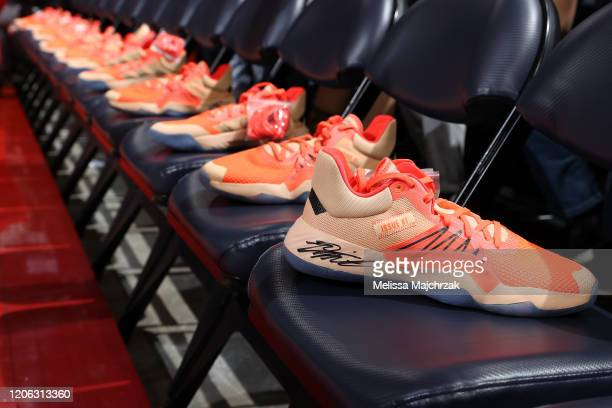 Donovan Mitchell of the Utah Jazz gives members of the Alpha Kappa Alpha Sorority sneakers in honor of National Women's day for the game against the...