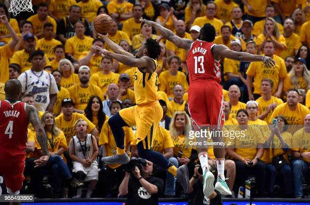 Donovan Mitchell of the Utah Jazz goes to the basket under the defense of James Harden of the Houston Rockets in the second half during Game Four of...