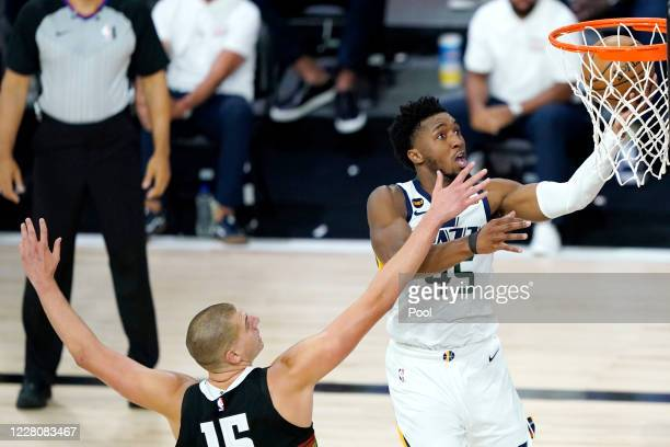 Donovan Mitchell of the Utah Jazz goes up for a shot against Nikola Jokic of the Denver Nuggets during the second half of an NBA basketball...