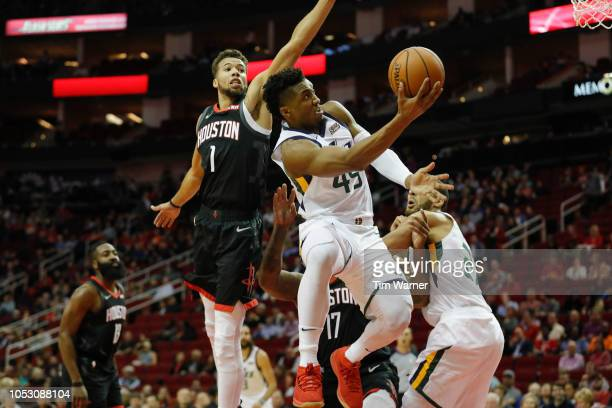 Donovan Mitchell of the Utah Jazz goes up for a shot defended by Michael CarterWilliams of the Houston Rockets in the first half at Toyota Center on...