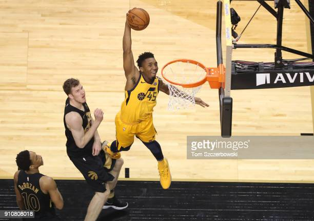 Donovan Mitchell of the Utah Jazz goes up to dunk the ball against the Toronto Raptors at Air Canada Centre on January 26 2018 in Toronto Canada NOTE...