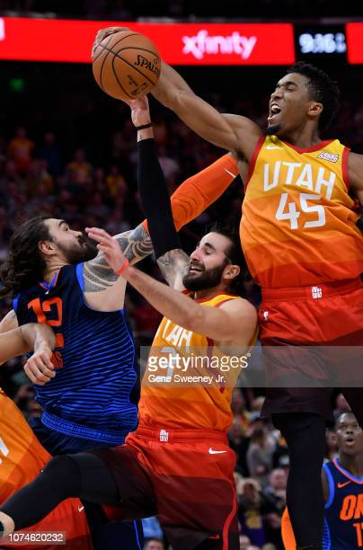 Donovan Mitchell of the Utah Jazz grabs the rebound over teammate Ricky Rubio and Steven Adams of the Oklahoma City Thunder in the second half of a...