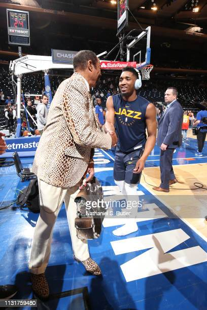 Donovan Mitchell of the Utah Jazz greets retired NBA Player Walt Frazier before the game against the New York Knicks on March 20, 2019 at Madison...