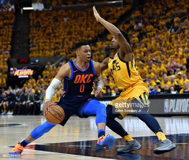Donovan Mitchell of the Utah Jazz guards against Russell Westbrook of the Oklahoma City Thunder in the first half during Game Six of Round One of the...