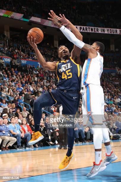Donovan Mitchell of the Utah Jazz handles the ball against the Oklahoma City Thunder on December 5 2017 at Chesapeake Energy Arena in Oklahoma City...