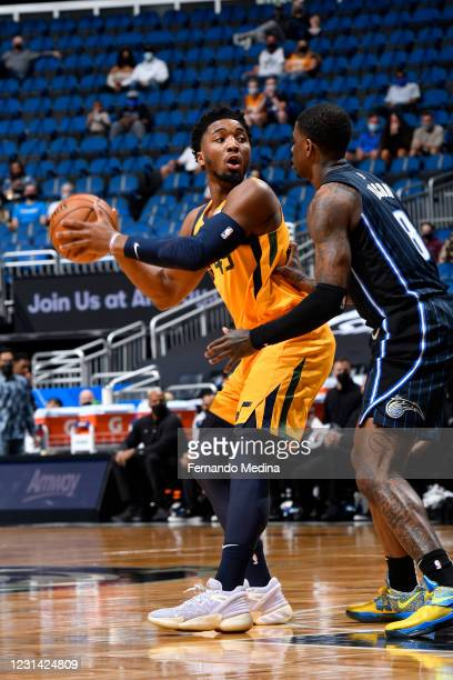 Donovan Mitchell of the Utah Jazz handles the ball during the game against the Orlando Magic on February 27, 2021 at Amway Center in Orlando,...