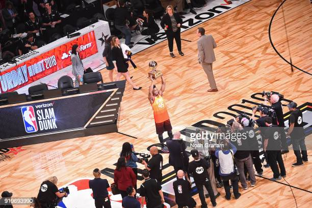 Donovan Mitchell of the Utah Jazz holds up the trophy after winning the Verizon Slam Dunk Contest during State Farm AllStar Saturday Night as part of...