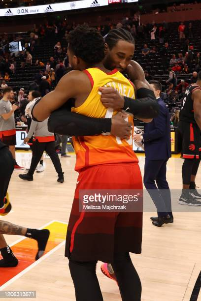 Donovan Mitchell of the Utah Jazz hugs Rondae HollisJefferson of the Toronto Raptors after the game on March 9 2020 at vivintSmartHome Arena in Salt...