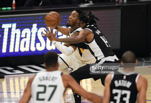 Donovan Mitchell of the Utah Jazz is defended by Terance Mann of the Los Angeles Clippers during the first half in Game Six of the Western Conference...