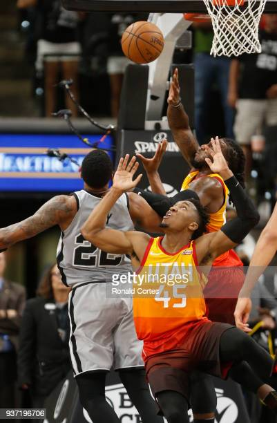 Donovan Mitchell of the Utah jazz looks for a rebound against the San Antonio Spurs at ATT Center on March 23 2018 in San Antonio Texas NOTE TO USER...