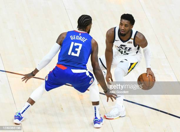 Donovan Mitchell of the Utah Jazz looks to drive around Paul George of the LA Clippers during a game at Vivint Smart Home Arena on January 1, 2021 in...