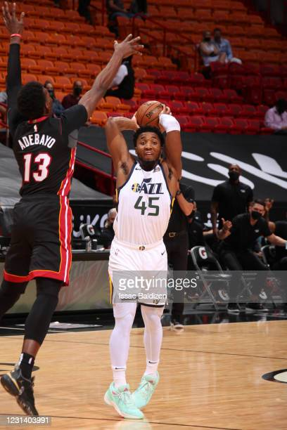 Donovan Mitchell of the Utah Jazz looks to pass the ball during the game against the Miami Heat on February 26, 2021 at American Airlines Arena in...