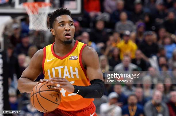 Donovan Mitchell of the Utah Jazz looks to pass the ball in a NBA game against the San Antonio Spurs at Vivint Smart Home Arena on February 09 2019...