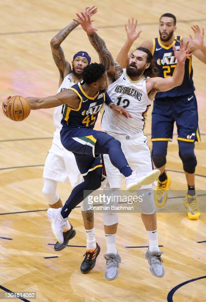 Donovan Mitchell of the Utah Jazz looks to pass to Rudy Gobert as Steven Adams and Brandon Ingram of the New Orleans Pelicans defend during the...