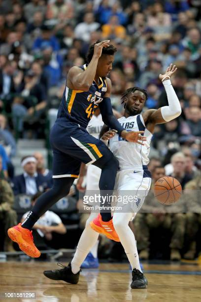 Donovan Mitchell of the Utah Jazz loses control of the ball against Wesley Matthews of the Dallas Mavericks in the second half at American Airlines...