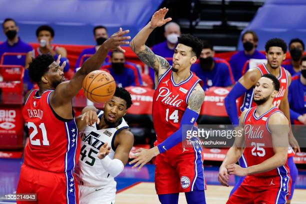 Donovan Mitchell of the Utah Jazz passes between Joel Embiid and Danny Green of the Philadelphia 76ers during the second quarter at Wells Fargo...