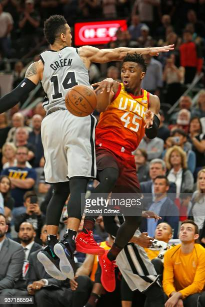 Donovan Mitchell of the Utah jazz passes off instead of taking a three as Danny Green of the San Antonio Spurs defends at ATT Center on March 23 2018...