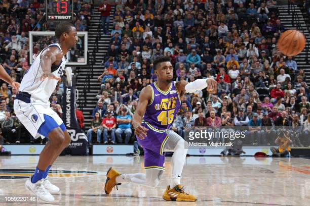 Donovan Mitchell of the Utah Jazz passes the ball against the Dallas Mavericks on November 7 2018 at vivintSmartHome Arena in Salt Lake City Utah...