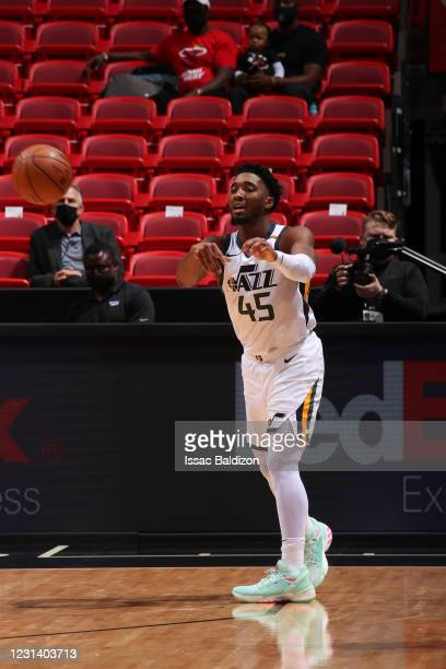 Donovan Mitchell of the Utah Jazz passes the ball during the game against the Miami Heat on February 26, 2021 at American Airlines Arena in Miami,...